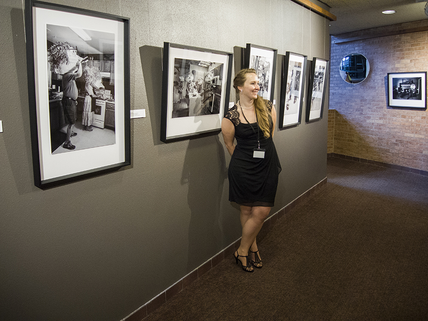 """A portrait of me among my work. I love all the images but """"Barefoot and Pregnant"""" has special meaning for me."""